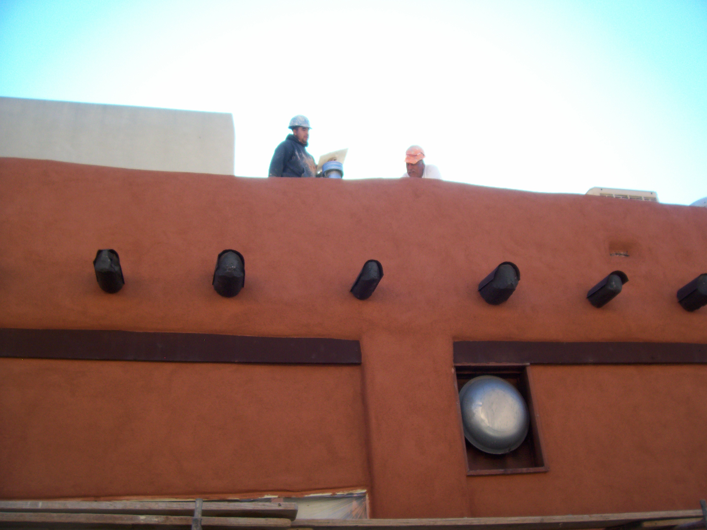 new stucco finish on exterior walls of a home