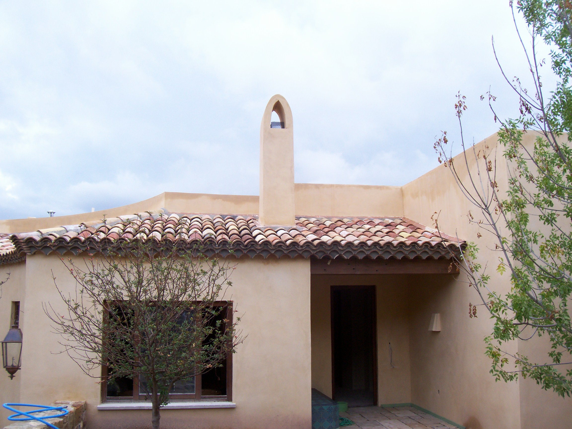 spanish style home with plaster exterior