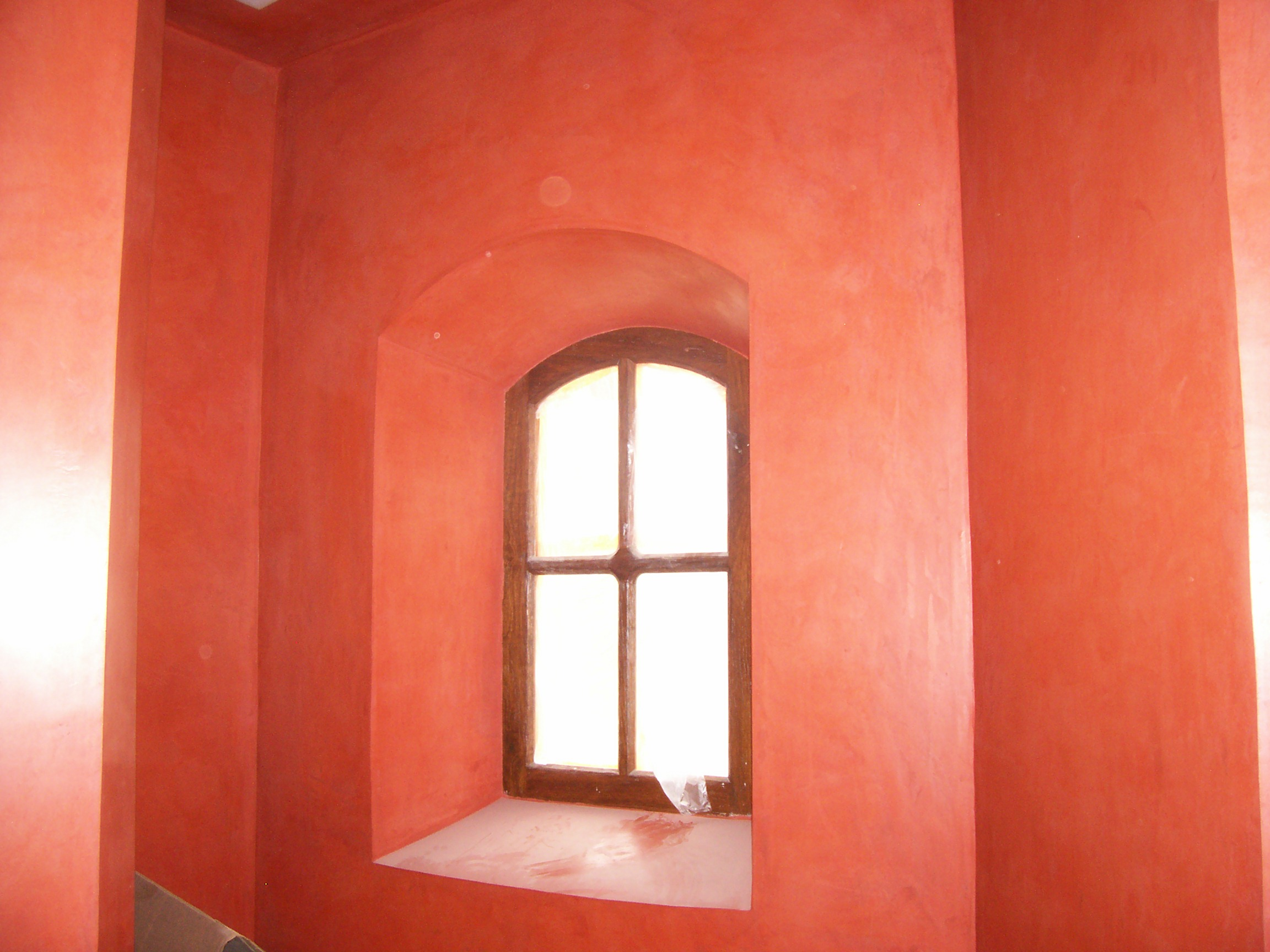 bright orange walls with a window